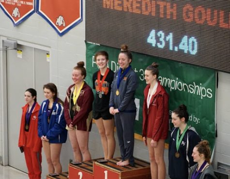 Meredith Gould stands on the first place stop atop the podium at the PA Districts meet on February 23rd, 2019. Gould has qualified for the State meet for three consecutive years, but this year marks her first time being named District Champion. (Via/Diana Pugliese)