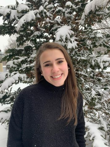 Moodie poses in the snow on February 11th, 2019. Picture taken during basketball season, which followed her experience with the state champion field hockey season. (Mary Cotter)