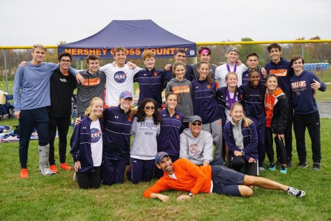 "The Hershey Cross Country team poses in front of their tent at the District III Championship meet on Saturday, October 26, 2019.  For the first time ""in nearly thirty years,"" both squads qualified for the state meet at the same time.  (Broadcaster/Robert Sterner)"