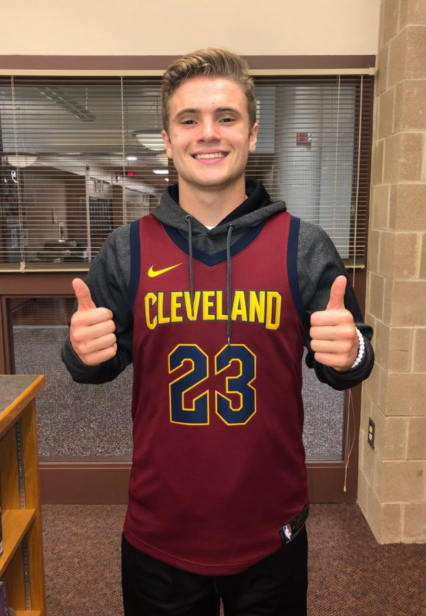 Senior+Anthony+Zimmerman+participates+in+the+first+day+of+spirit+week%2C+jersey+day.+He+is+wearing+a+throwback+Lebron+James+Basketball+jersey.+%28Broadcaster%2FOlivia+Bratton%29