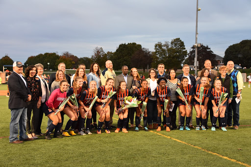 The Hershey High School Girls Soccer seniors pose for a picture with their parents after the Senior Night announcements. Senior Night was on October 7, 2019, vs. Palmyra Area High School. (Broadcaster/Kate Clark)