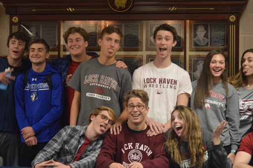 Tanner Updegraff poses with his friends in Lock Haven apparel. Updegraff transferred to Hershey his junior year, and in his first season at HHS, he placed third at the PIAA state tournament. (Broadcaster/Katie Jones)