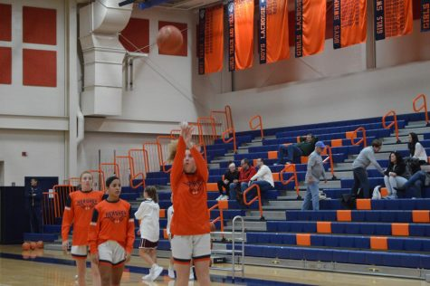 Hershey sophomore Mary Cotter shoots the ball during warmups. The Trojans lost 36-29. (Broadcaster/Joshua Gearhart)