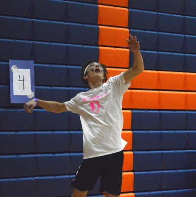 Luke Reid serves the ball during the 11 o'clock hour of the tournament. Students who participated in the volleyball tournament earlier payed an entry fee of five dollars which would go towards Mini-Thon and the Herren Project. (Broadcaster/Anna Callahan)