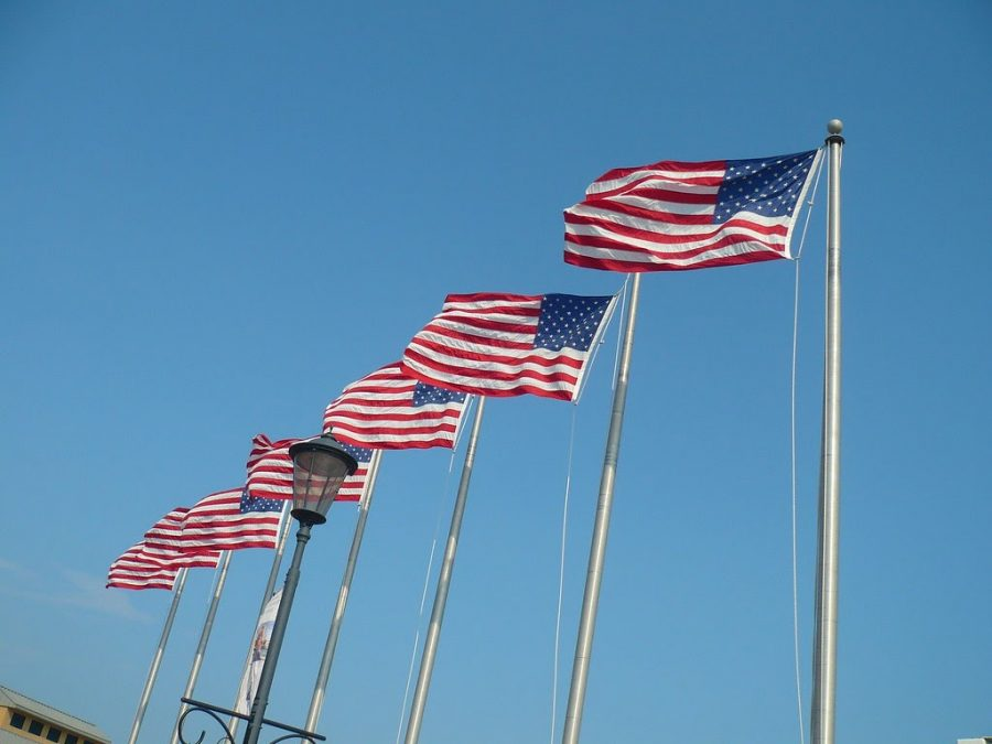Flags stand in a row in the sunlight. Flag Day is celebrated on June 14 every year. (Creative Commons)
