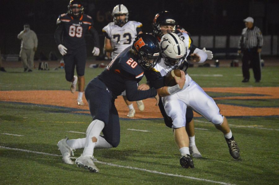 Seniors Ian McCormick and Owen Weaber band together to make the tackle. McCormick had five tackles and Weaber nine. (Broadcaster/Josh Gearhart)