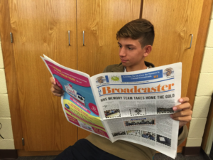 Henry Isaacson, sophomore, enjoys a vintage copy of The Broadcaster on Monday, September 21. Isaacson read this old copy for inspiration for his own stories.