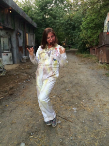 """Carly Morelli shows off her bloody get up as she plays a psycho in the """"Haunted Hayride"""" at Field of Screams in late 2014. She gets ready to scare before taking her place."""