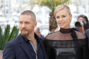 Tom Hardy and Charlize Theron pose for photographers during a photo call for the film Mad Max : Fury Road, at the 68th international film festival, Cannes, southern France, Thursday, May 14, 2015. (Photo by Joel Ryan/Invision/AP)