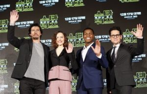 "Actor Adam Driver, left, actress Daisy Ridley, second from left, actor John Boyega, second from right, and director J.J. Abrams pose for the media during a press conference for their new movie ""Star Wars: The Force Awakens,"" in Seoul, South Korea, Wednesday, Dec. 9, 2015. The movie is to be released in South Korea on Dec. 17. (AP Photo/Lee Jin-man)"