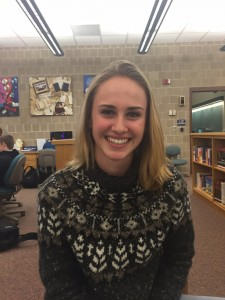 Caroline Sinz, currently an HHS junior, poses for a photo in the high school library on January 11th, 2016. Sinz reminisced about her school year abroad in Spain her sophomore year.