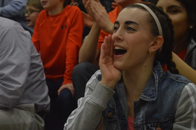 Senior+Kate+Zurlo+cheers+at+halftime+while+students+shoot+half+court+shots.+%28Broadcaster%2FBella+D%E2%80%99Adderio%29%0A
