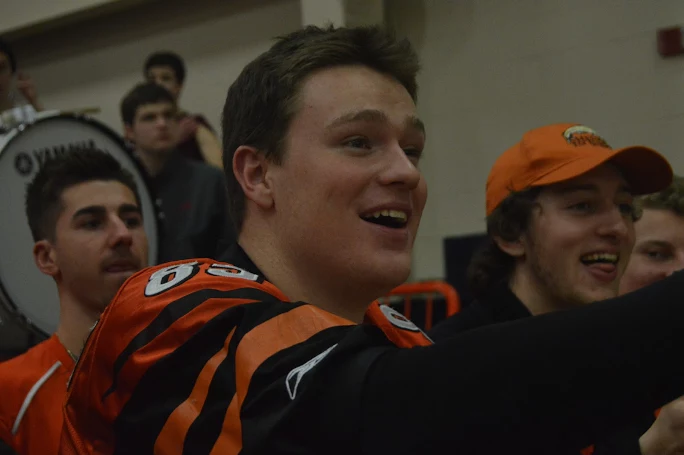 Jimmy+Sheehan%2C+HHS+senior%2C+laughs+at+the+game+while+also+supporting+his+teachers+against+Lower+Dauphin.+%28Broadcaster%2FBella+D%E2%80%99Adderio%29%0A