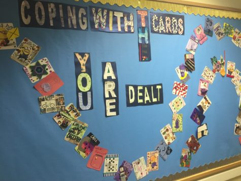 """A poster reading """"Coping With the Cards You Are Dealt"""" gives young people's perspectives of coping and handling their disorders. It was worked on by a number of patients to reassure them that they have support and will get better in a matter of time. Taken on November 2, 2015 in the Briarcrest Adolescent Medicine."""