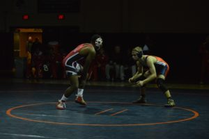 Junior Alan Spicer circles Susquehanna's Michael Perry during the 145lb match.  Spicer fell on a 5-3  decision.