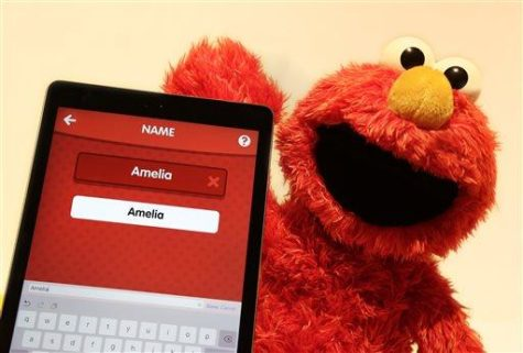 In this Monday, Feb. 15, 2016, photo, Love 2 Learn Elmo is shown with a personalized iPad app from Hasbro at Toy Fair in New York. (AP Photo/Mark Lennihan)