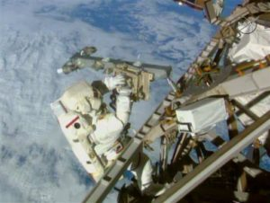 In this Sunday, March 1, 2015 image made from video provided by NASA, astronaut, Terry Virts, installs an antenna and boom during a spacewalk outside the International Space Station. On Friday, Feb. 19, 2016, NASA announced it received a record number of applicants _ some 18,300 _ for its next astronaut class. That's more than double the previous record of 8,000 for the first space shuttle astronaut class in 1978. (AP Photo/NASA-TV)
