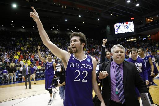 Holy Cross' Robert Champion (22) celebrates after the team's First Four game against Southern University in the NCAA college basketball tournament Wednesday, March 16, 2016, in Dayton, Ohio. Holy Cross won 59-55 (AP Photo/John Minchillo).