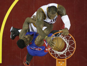 Cleveland Cavaliers' LeBron James, top, dunks the ball against Detroit Pistons' Reggie Bullock in the first half in Game 2 of a first-round NBA basketball playoff series, Wednesday, April 20, 2016, in Cleveland. (AP Photo/Tony Dejak)