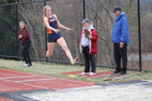 Cotton jumps into the sand pit while competing the long jump during her sophomore year track season. Cotton was not able to compete the next season due to an injury to her ACL the next year.