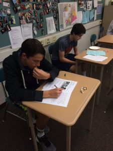 Freshmen, Jack Wetherhold (left) and Kurt Steinruck, write letters to U.S. service members on Friday, April 29, 2016. The students wrote what they admire about soldiers in the military.