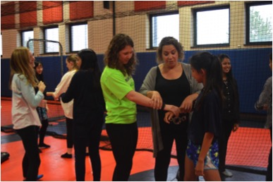 Self defense class empowers young women at HHS on Community Day