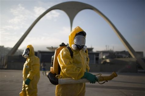A health workers stands in the Sambadrome spraying insecticide to combat the Aedes aegypti mosquito that transmits the Zika virus in Rio de Janeiro, Brazil on Jan. 26, 2016. The Sambadrome will be used for the Archery competition during the 2016 Olympic games. With the opening ceremony less than three months away, a Canadian professor has called for the Rio Olympics to be postponed or moved because of the Zika outbreak, warning the influx of visitors to Brazil will result in the avoidable birth of malformed babies. The IOC and World Health Organization disagree, saying Zika will not derail the games.   (AP Photo/Leo Correa, File)