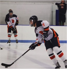 Sammy Steele, a sophomore at HHS, holds the puck during a Hershey Ice Hockey game. Steele has played ice hockey since the age of age.  (Submitted: Sammy Steele)