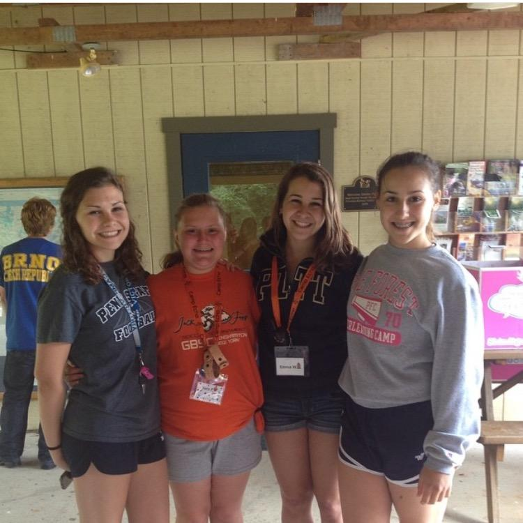Junior Erin Wolfe (right) poses with her sisters and another camper at Camp Echo. Wolfe will be a head counselor at camp this year. (Photo Courtesy of Erin Wolfe)