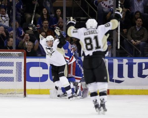 Pittsburgh Penguins' Sidney Crosby, left, and Phil Kessel (81) react after Crosby scored the winning goal during the overtime period of the NHL hockey game, Sunday, March 27, 2016, in New York. The Penguins defeated the Rangers 3-2. (AP Photo/Seth Wenig)