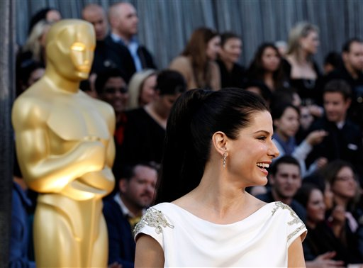 Sandra Bullock arrives before the 84th Academy Awards on Sunday, Feb. 26, 2012, in the Hollywood section of Los Angeles. (AP Photo/Matt Sayles)