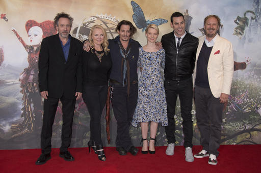 Executive producer Tim Burton, from left to right, producer Suzanne Todd, actors Johnny Depp, Mia Wasikowska, and Sacha Baron Cohen alongside director James Bobin, pose for photographers at the photo call of Alice Through The Looking Glass, at a central London hotel, Sunday, May 8, 2016. (Photo by Joel Ryan/Invision/AP)