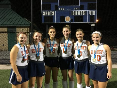 Left to right: HHS seniors Taylor Massage, Natalie Sicher, Mya Christopher, Jacqui Foley, Katie McCartney, and Ali Cronin pose for a photo while wearing their Mid Penn Champion metals. The field hockey team beat East Pennsboro 4-0. (Broadcaster/ Bella D'Adderio)