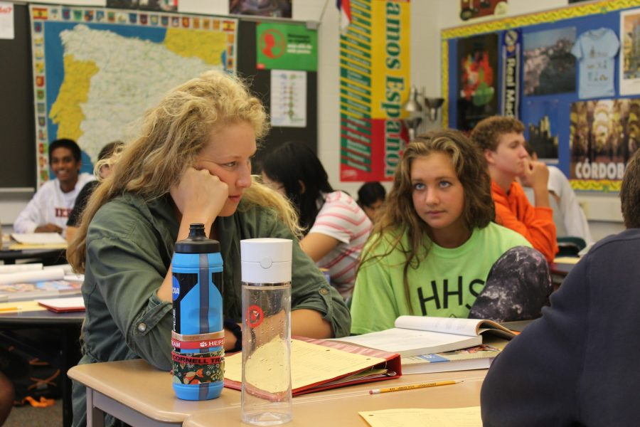 Emily Nolan, left, and Hannah Jones, right, patiently listen to the Spanish 5 listening activity. Nolan and Jones both glanced around the room while concentrating on this intricate assignment. (Broadcaster/Lindsey Voyles)