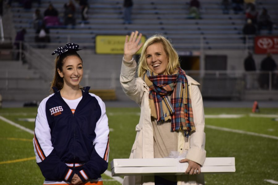 On Friday September 30, 2016, Sarah Wilhite, right, waves to the Hershey crowd after being escorted across Hersheypark stadium by senior Julia Rippon, left. Wilhite is a 2005 graduate of Hershey High. (Broadcatser/Mallory Drayer)