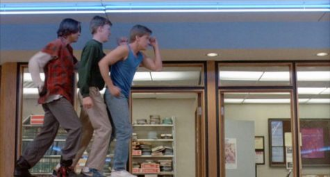 John, Brian, and Andrew dance in the library. The kids put-on an 80s montage. (Photo courtesy of Universal Pictures)