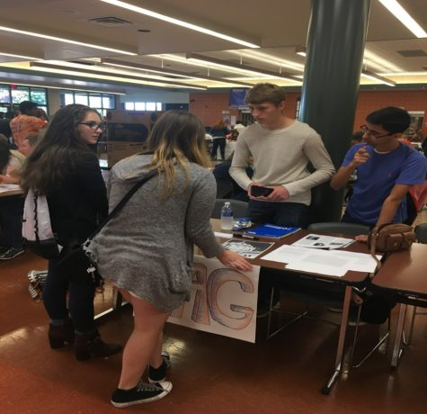 Sawyer Smith (middle right) and Varun Sharma (far right) explaining what YAG is like to Damla Undar (far left) and Stella Del Carmen (middle left) at clubfest in the cafeteria of HHS. The Youth and Government members explained the events that they were looking forward to: the model and the election convention. (Broadcaster/Evan Spinney)