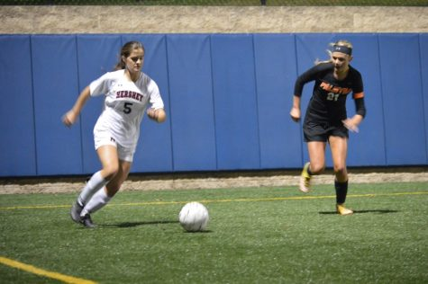 Star player of the night, junior, Lauren Epler, is taking control of the ball. Epler made three out of the four goals during the game. (Broadcaster/Azelin Thompson)