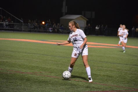 Katelyn Cocco, number 12, keeps the ball close to her. Cocco ended the game with one assist. (Broadcaster/Azelin Thompson)