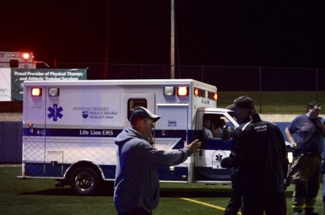 A Penn State Hershey Life Lion EMS ambulance drives onto the field. A referee had collapsed due to an apparent heart attack. The referee left in an ambulance but was responsive. (Broadcaster/Azelin Thompson)