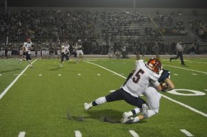 Junior Ryan Nerino tackles Cedar Cliff player during their game on Friday, October 7.  Nerino has been the quarterback for the Trojans for the past two years. (Broadcaster/Anna Levin)