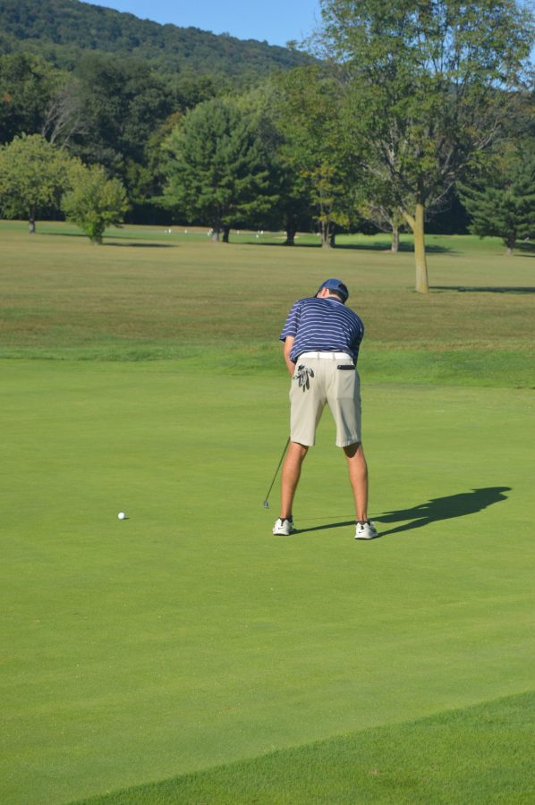 Junior, Patrick Larkin, sinks a putt to earn him the second ranking spot. The Trojans played at the Manada Golf course on Thursday, September 22, 2016. (Broadcaster/ Mallory Drayer)
