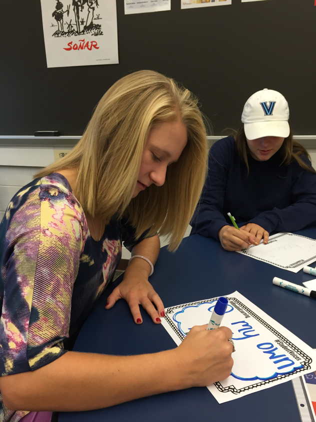"""On Friday, October 7, 2016, Senior Sarah Haverstick writes why she enjoys blended learning. She and fellow senior, Hayley Terhaar, created the """"Cocoa Community"""" program to help the middle schoolers transition into the High School. (Broadcaster/Mallory Drayer)"""
