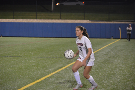 During the girl's varsity soccer game sophomore, Maggie Gleason is getting ready to pass the ball back in. She took a step forward and went for it. (Broadcaster/Azelin Thompson)