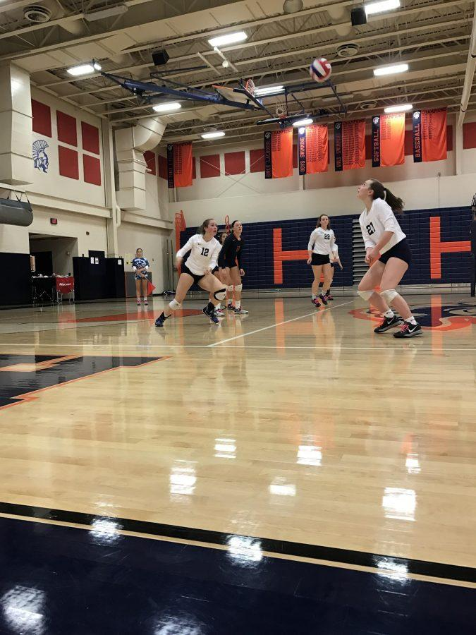 Junior Lilly Strader passes the ball to Lizzy Zieber during the girls volleyball game on their senior night. Hershey lost to LD 0-3. (The Broadcaster/ Sofia Suri)