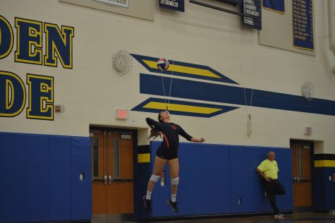 Ali Gmerek, 12th grade, jumps high to hit her jump serve at the girls volleyball game on Thursday against Waynesboro. (Broadcaster/Brooke Daniels)