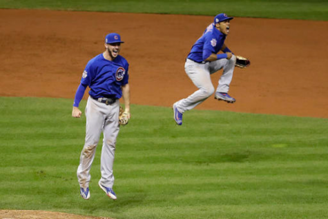 Chicago Cubs' Kris Bryant, left, and Addison Russell begin to celebrate after the final out of Game 7 of the Major League Baseball World Series against the Cleveland Indians Wednesday, November 2, 2016, in Cleveland. Chicago won 8-7 in ten innings. (AP Photo/Gene J. Puskar)
