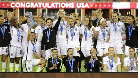 The U.S. Women's soccer team celebrates after winning the CONCACAF Olympic women's soccer qualifying championship final against Canada Sunday, Feb. 21, 2016, in Houston. The U.S. won 2-0. (AP Photo/David J. Phillip)
