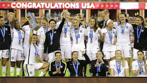 The U.S. Womens soccer team celebrates after winning the CONCACAF Olympic womens soccer qualifying championship final against Canada Sunday, Feb. 21, 2016, in Houston. The U.S. won 2-0. (AP Photo/David J. Phillip)