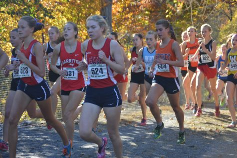 Taylor Mortensen, senior, runs by shortly after the start of the 5k race. Mortensen placed 49th overall. (Broadcaster/Moxie Thompson)